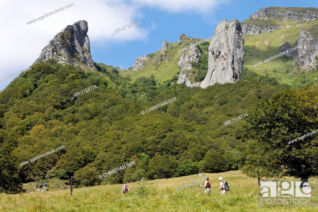 Stock Photo: Hikers in Chaudefour Valley natural reserve, Parc Naturel Regional des Volcans d'Auvergne, Auvergne Volcanoes Regional Nature Park, Puy de Dome, France, Europe.