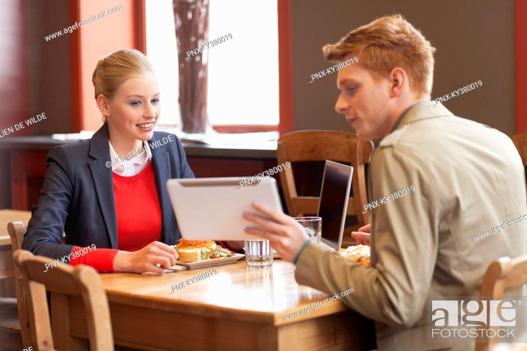 Stock Photo: Couple sitting in a restaurant.