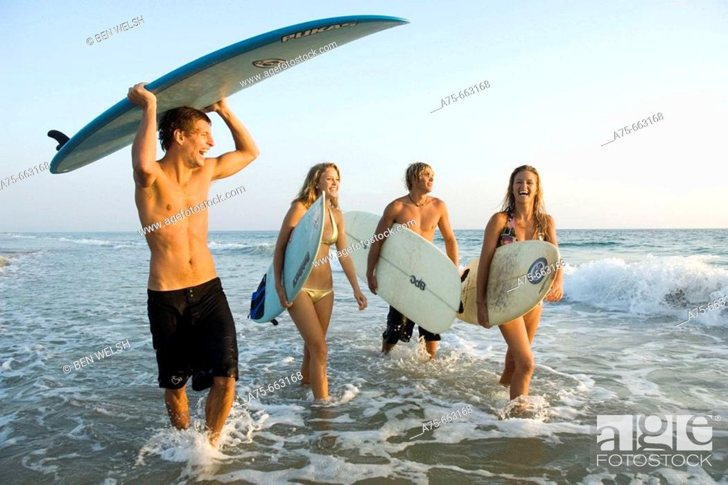 Stock Photo: group of young surfers.