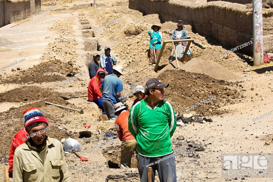 Stock Photo: High angle view of a group of people digging a road, Puno, Cuzco, Peru.