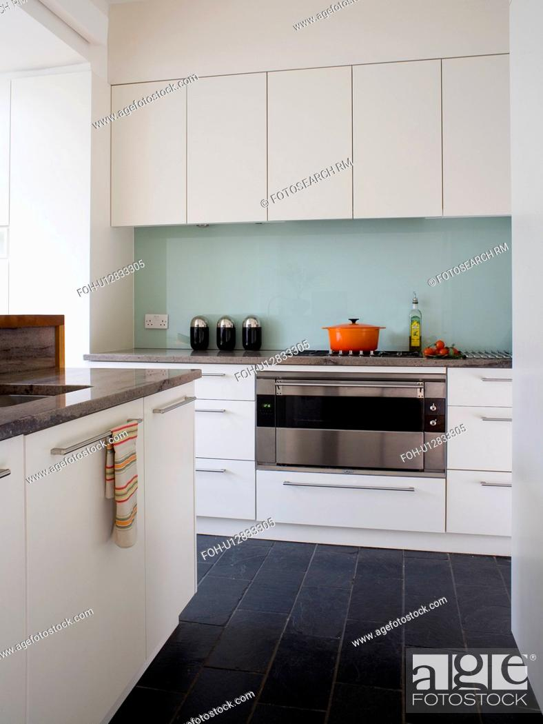 Black Floor Tiles In Modern White Kitchen With Glass Splashback Behind Stainless Steel Oven Stock Photo Picture And Rights Managed Image Pic Foh U12833305 Agefotostock