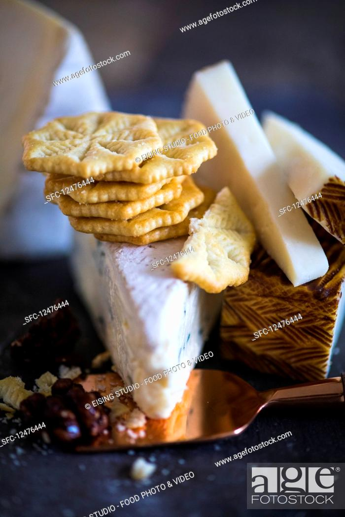 Stock Photo: Crackers and various tYespes of cheese.
