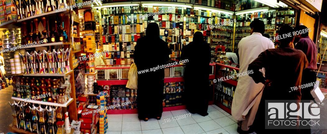 Abu Dhabi UAE Traditional Perfume Shop Veiled Women Souk, Stock