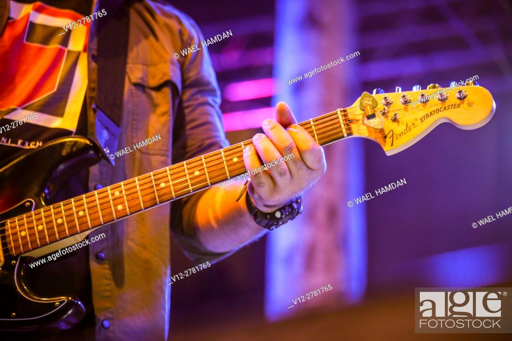 Stock Photo: man playing electric guitar on stage.