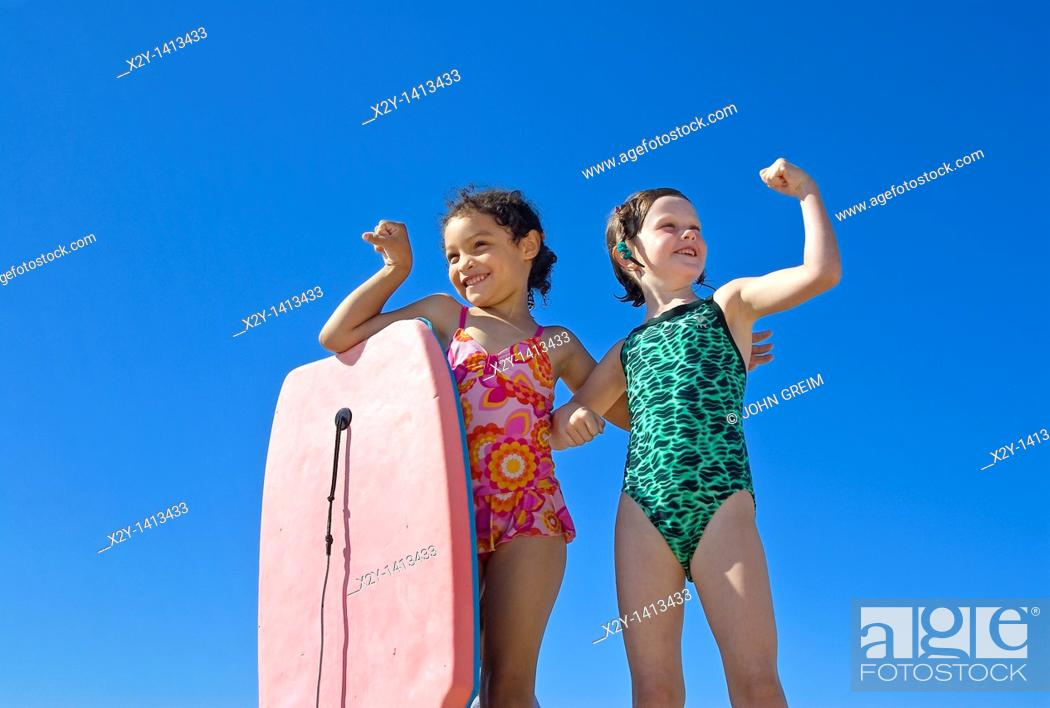 Stock Photo: Girl friends hamming it up at the beach, Paines Beach, Cape Cod MA.