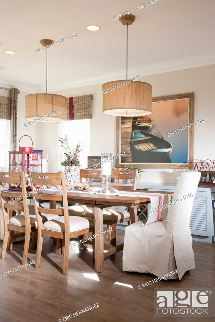 Chairs At Dining Table With Hanging Lights Home Stock
