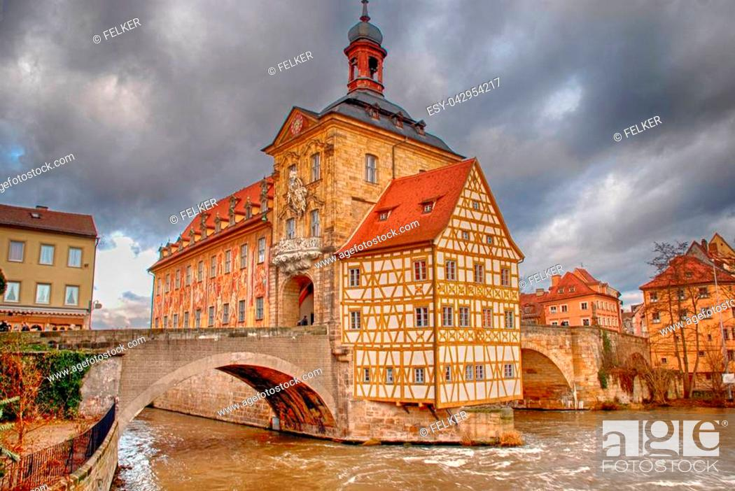 Stock Photo: The Old Town Hall (1386) of Bamberg(Germany) was built in the middle of the Regnitz river, accessible by two bridges . The Old Town of Bamberg is listed as a.