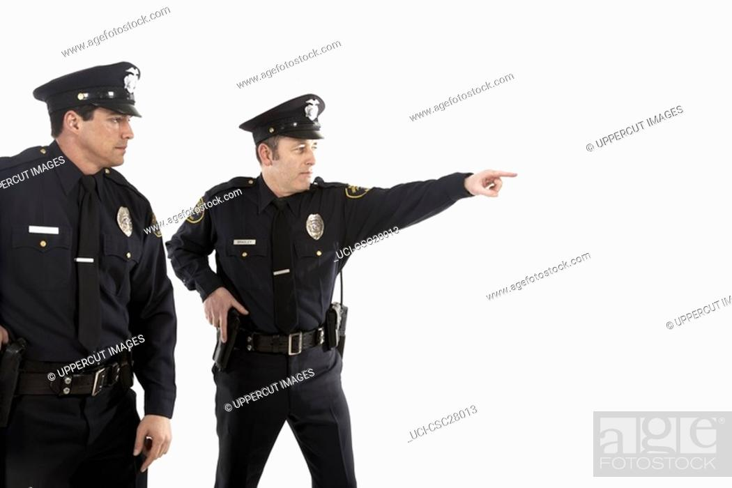 Stock Photo: Male police officers pointing.