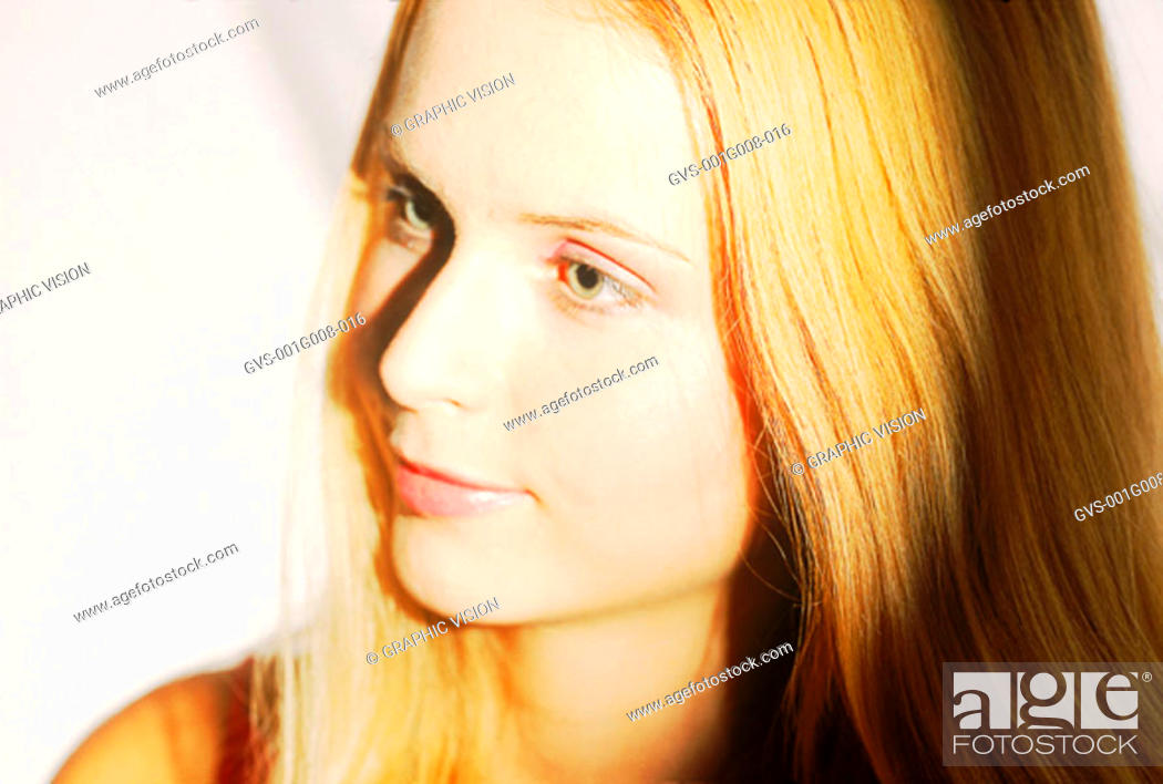 Stock Photo: Close -up of a young woman looking sideways.