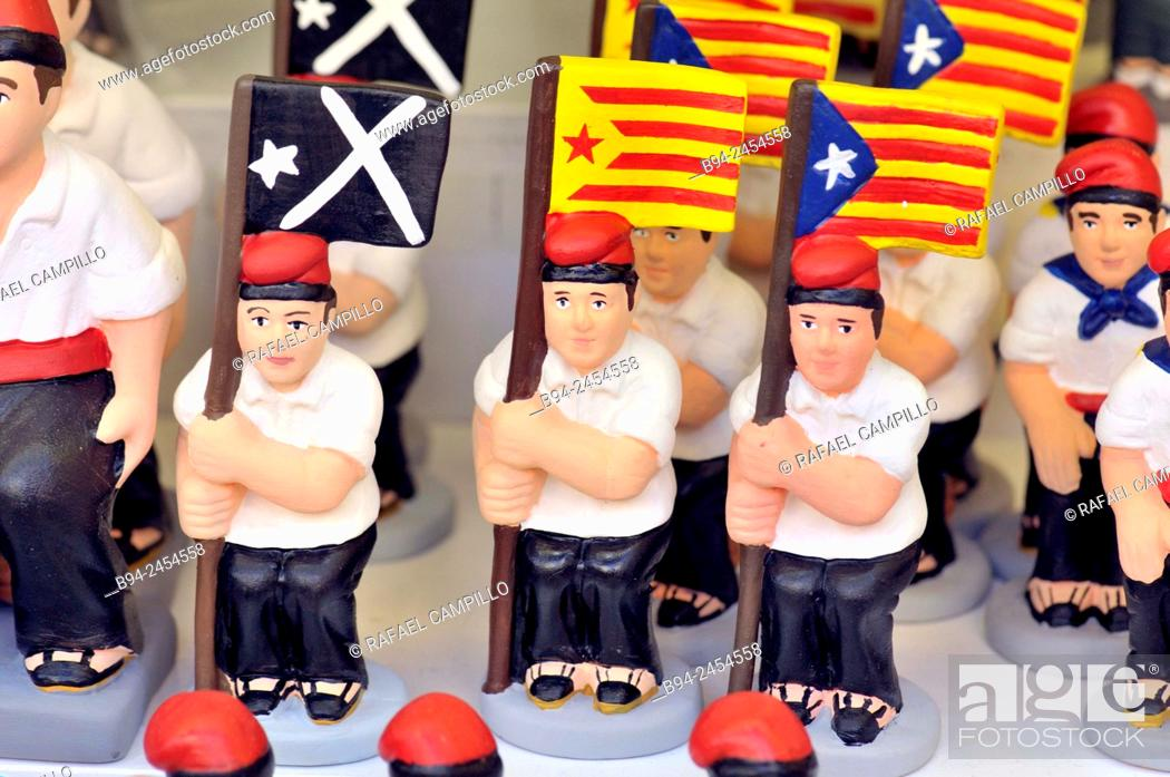 Stock Photo: 'Caganers', Catalonia independent flag, particular feature of modern nativity scenes at Santa Llucia Christmas fair, Barcelona. Catalonia, Spain.
