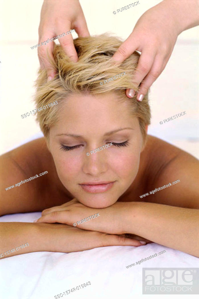 Stock Photo: Young woman getting a head massage.