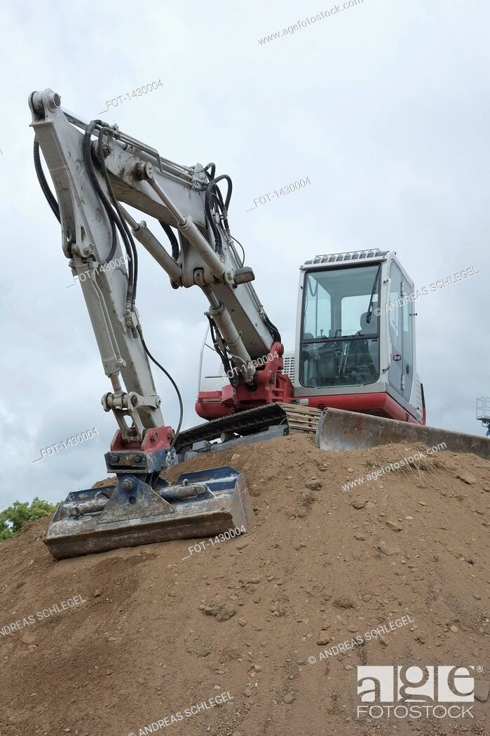 Stock Photo: Low angle view of excavator at construction site.