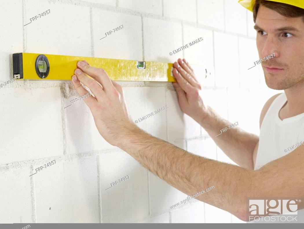 Stock Photo: Construction worker with spirit level.