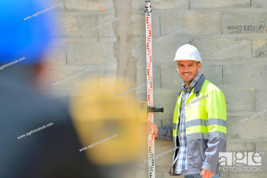 Stock Photo: Surveyor and colleague working on site.