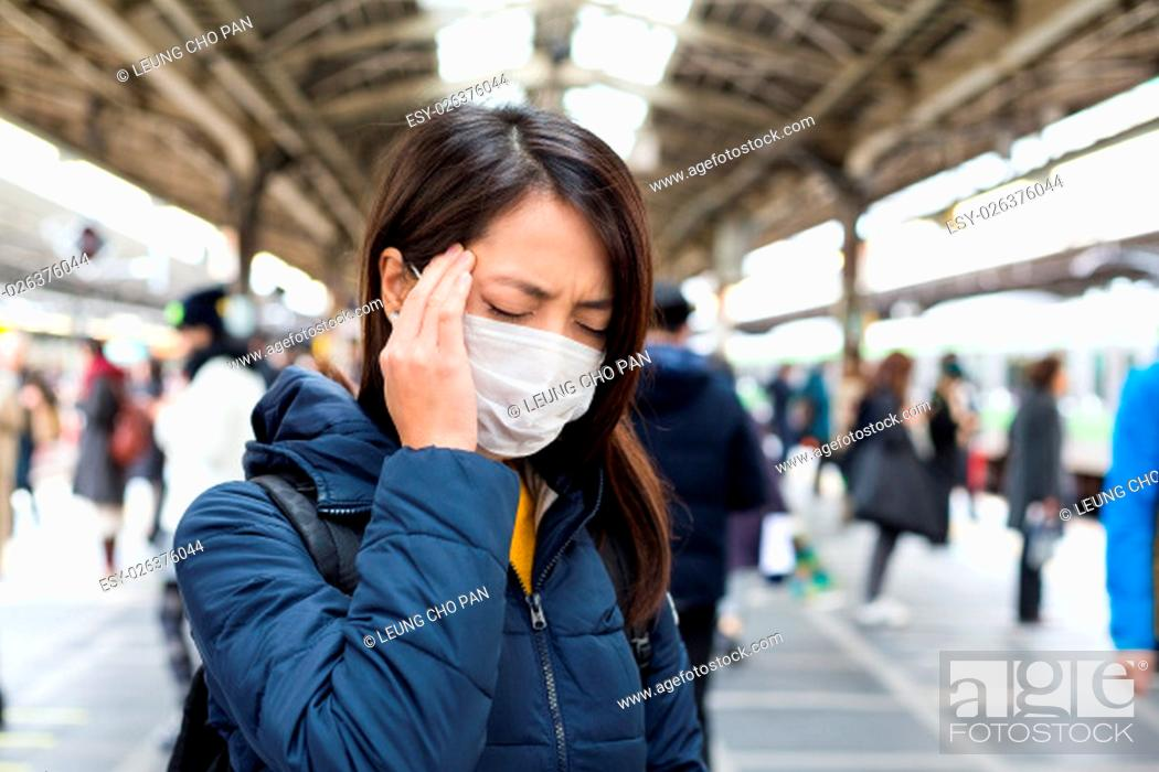 Stock Photo: Woman feeling unwell in train station.
