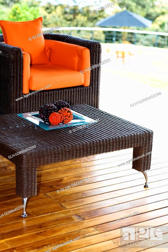 Stock Photo: Table and an armchair on the patio.