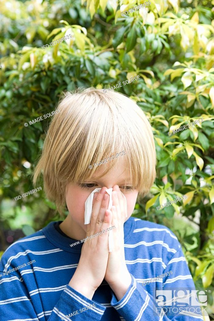 Stock Photo: Boy blowing his nose.