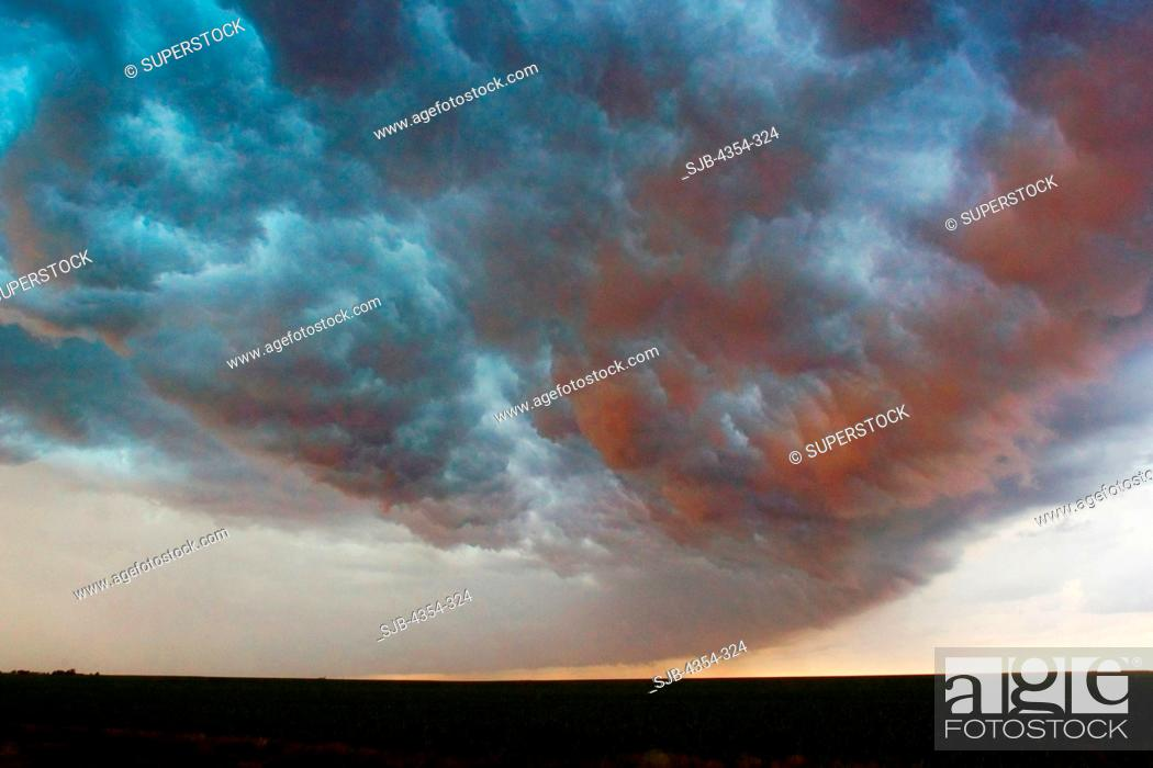 Stock Photo: Reverse Side of a Shelf Cloud Broils Across the Sky.