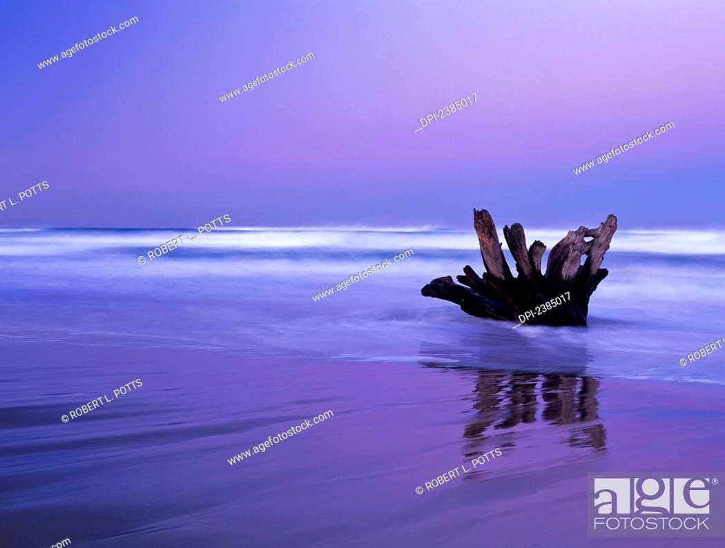 Stock Photo: Waves break on the beach at dawn; Winchester Bay, Oregon, United States of America.