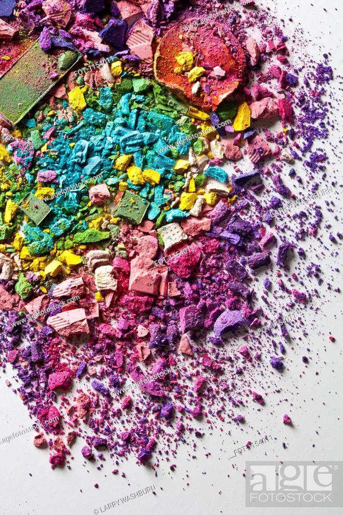 Stock Photo: Various crushed up make-up powder products arranged in an abstract pattern.