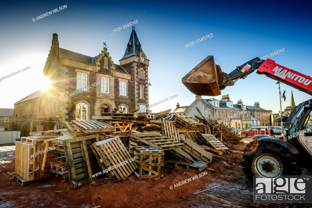 Stock Photo: Work on building the famous Biggar bonfire continues throughout December before it is lit on Hogmanay (New Years Eve) 31st December to celebrate the new year.