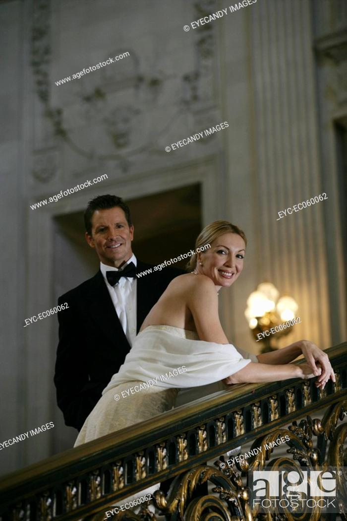 Stock Photo: Mature couple on staircase looking at camera.