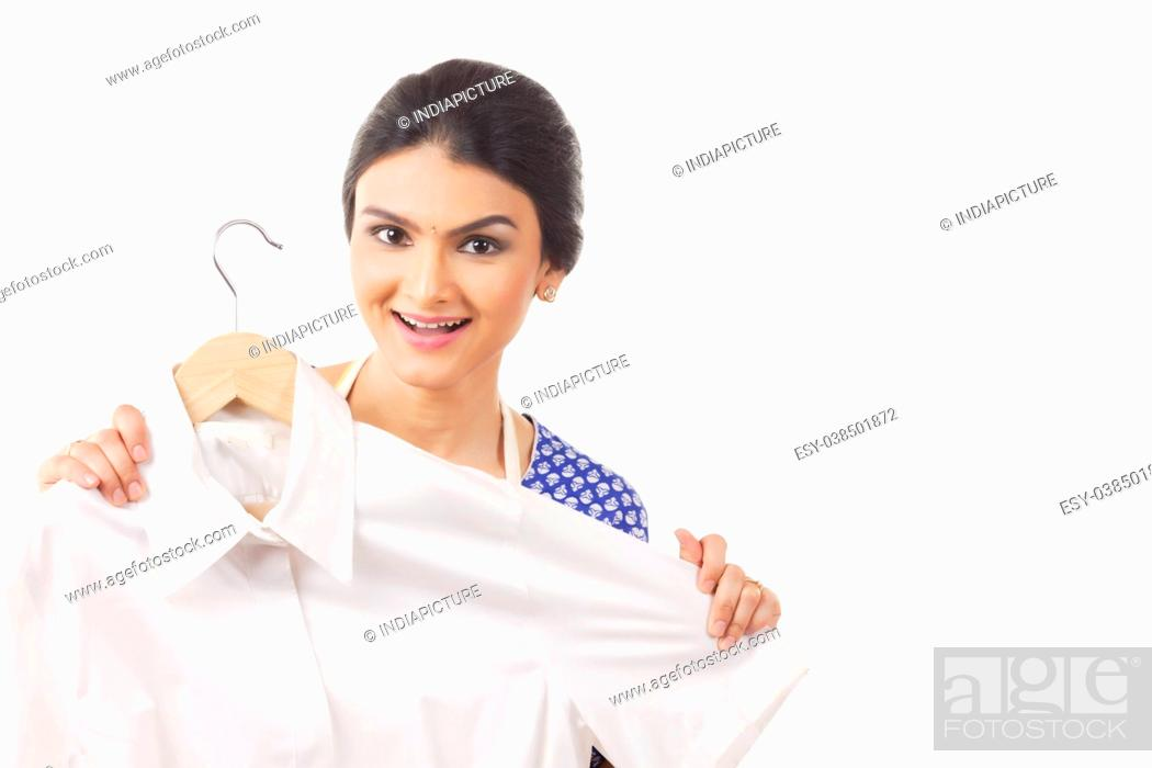 Stock Photo: beautiful housewife showing a shirt.
