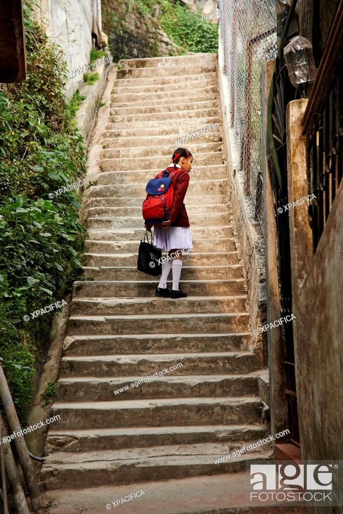 A Young School Girl Walking Up The Stairs Curious Looks At Something