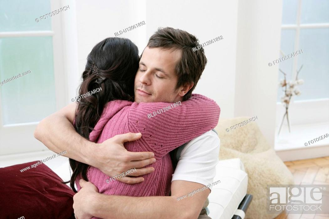 Stock Photo: Mid adult couple hugging.