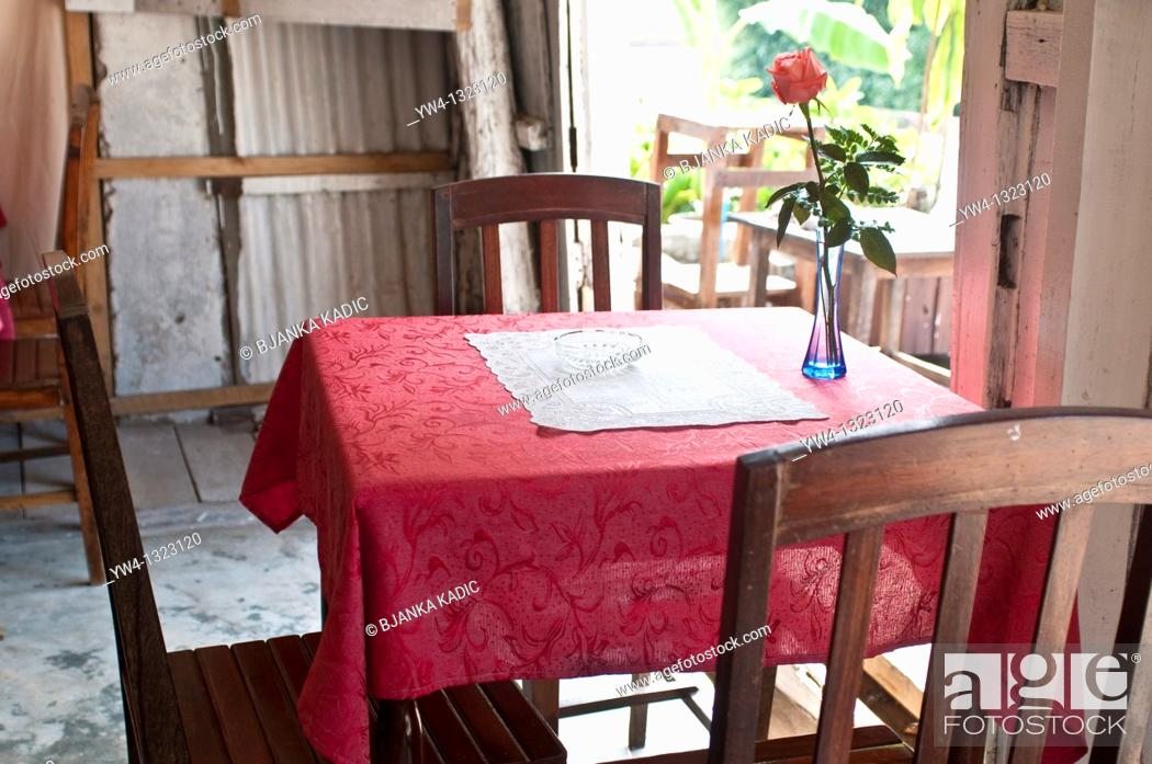 Stock Photo: Humble French style cafe with a rose on a table, Luang Prabang, Laos.
