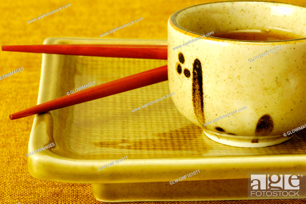 Stock Photo: Close-up of a bowl of soy sauce with chopsticks on a serving tray.