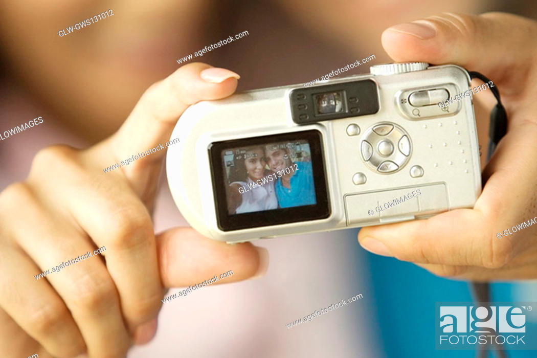 Stock Photo: Close-up of a person's hand holding a digital camera.