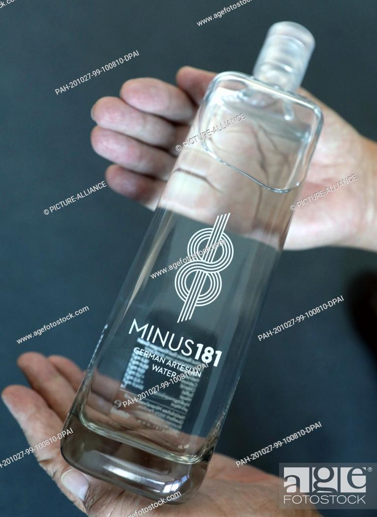 "Stock Photo: 27 October 2020, Mecklenburg-Western Pomerania, Rostock: A man holds a bottle of luxury mineral water of the brand """"Minus 181"""" for about 20 euros from Parchim."