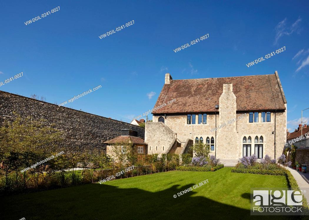 Stock Photo: Garden with Grade II listed building by William Butterfield and boundary wall. Kingsdown House, King's Canterbury, Canterbury, United Kingdom.