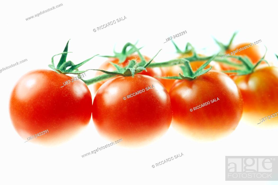 Stock Photo: Cherry Tomatoes Isolated on a White Background. . . .