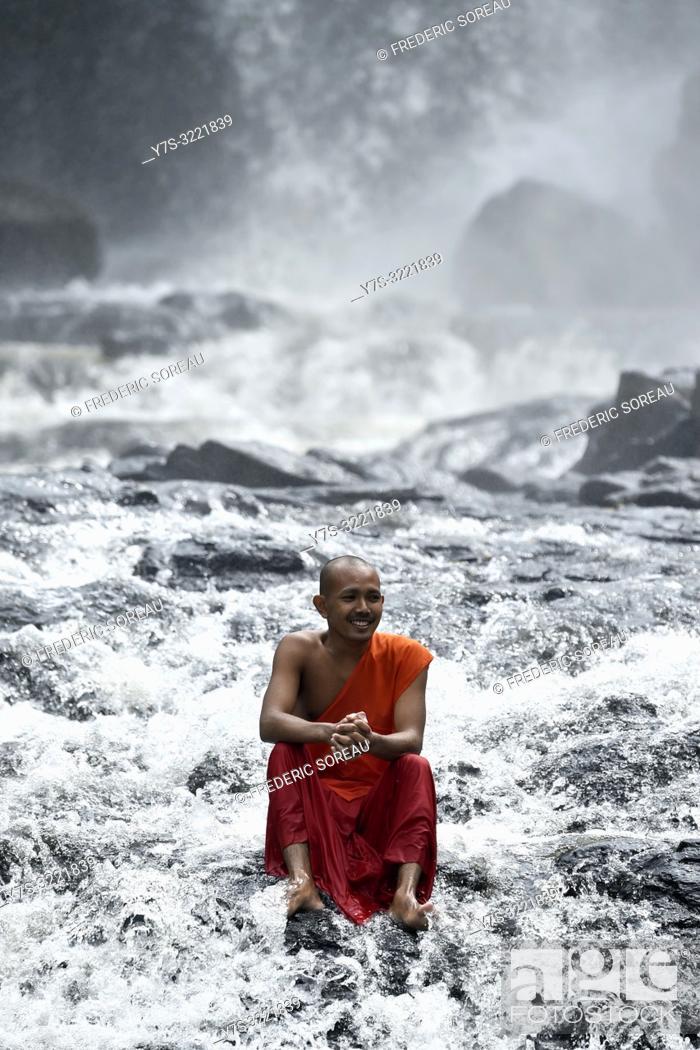 Stock Photo: Novice monks play at Bou Sra waterfall near Sen Monorom, Mondolkiri province, Cambodia, South east Asia.