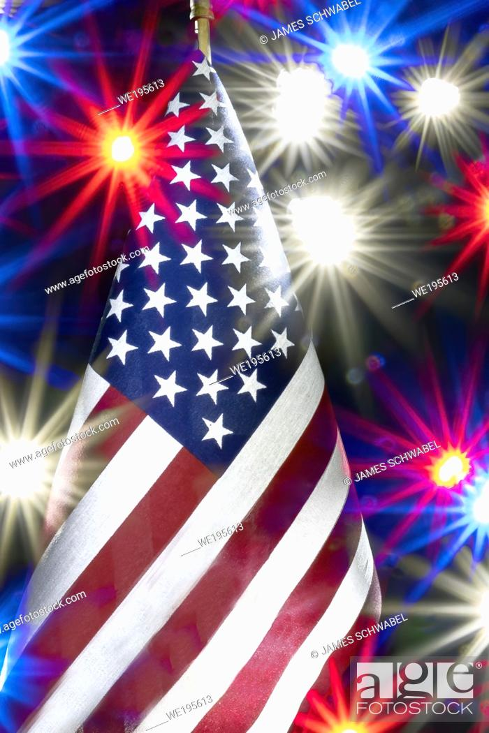 Stock Photo: Single American flag with colored light bursts around flag.