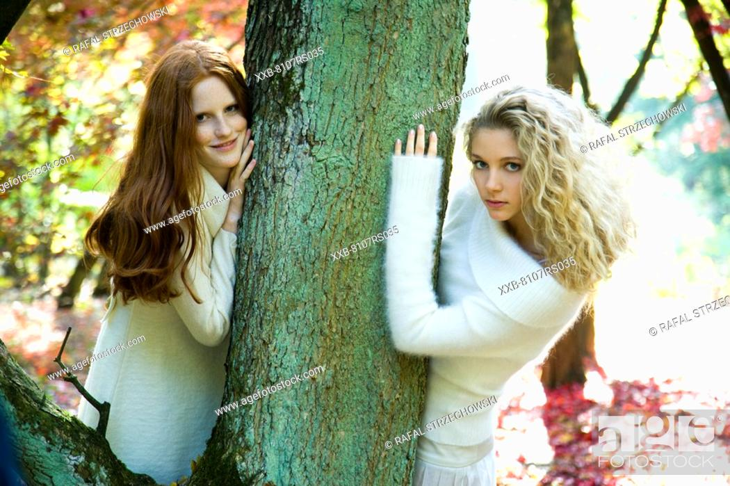 Stock Photo: Autumn portrait of young women.