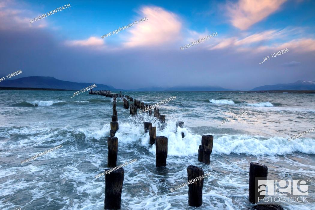 Stock Photo: 'Braun & Blanchard' famous old pier, storm approaching at sunset, Puerto Natales, Patagonia, Chile.