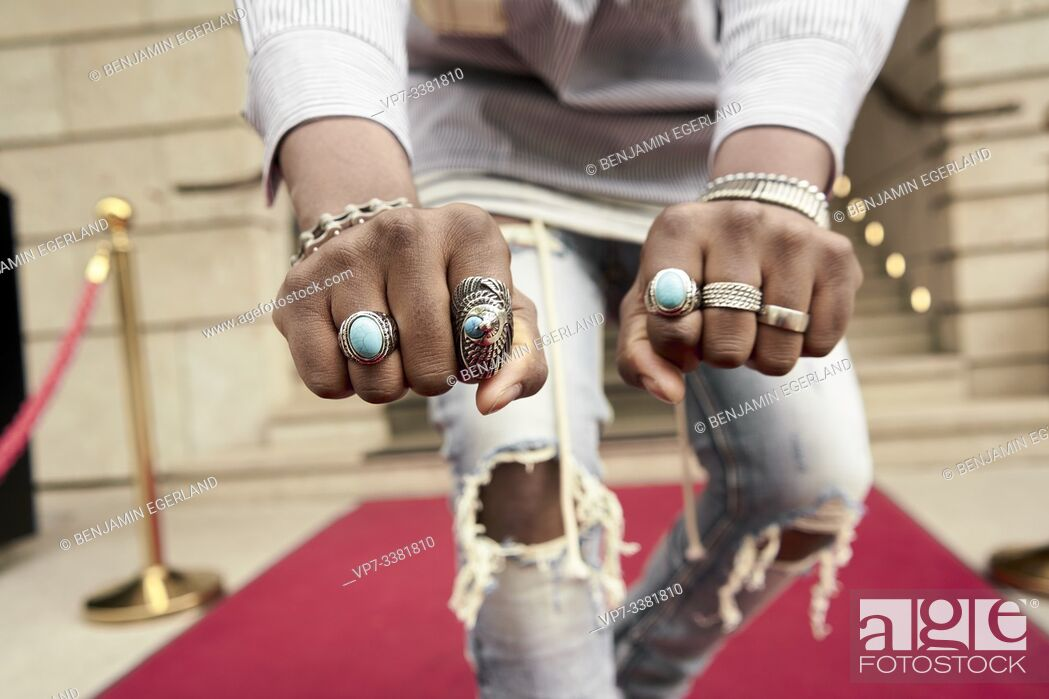 Stock Photo: jewelry rings on hand of famous celebrity on red carpet.