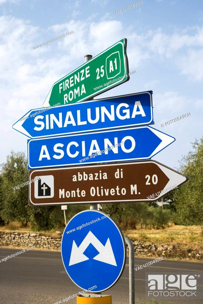 Stock Photo: Road signs pointing different directions in Tuscany, Italy.