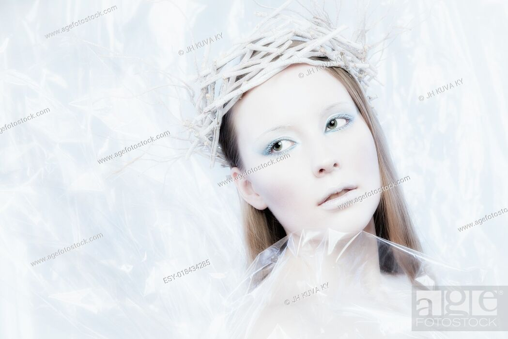 Stock Photo: Fantasy ice queen theme, young beautiful woman, studio shot.