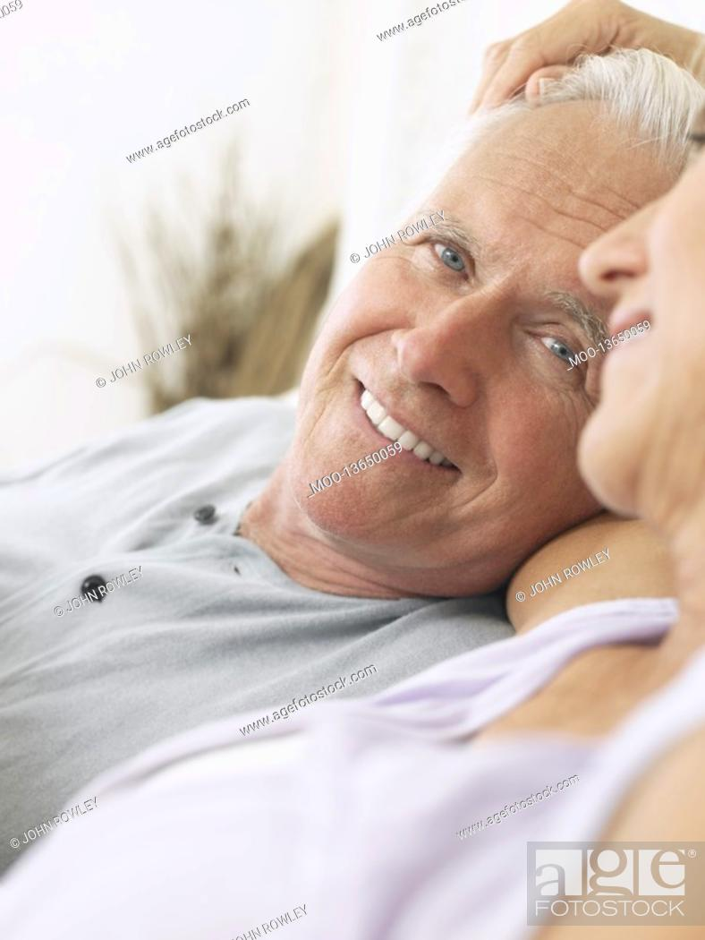 Stock Photo: Couple embracing and smiling close-up.