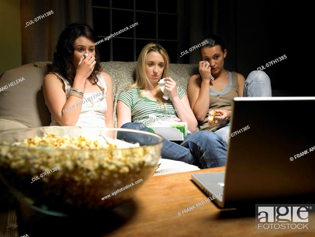 Stock Photo: Three young women watching a movie.