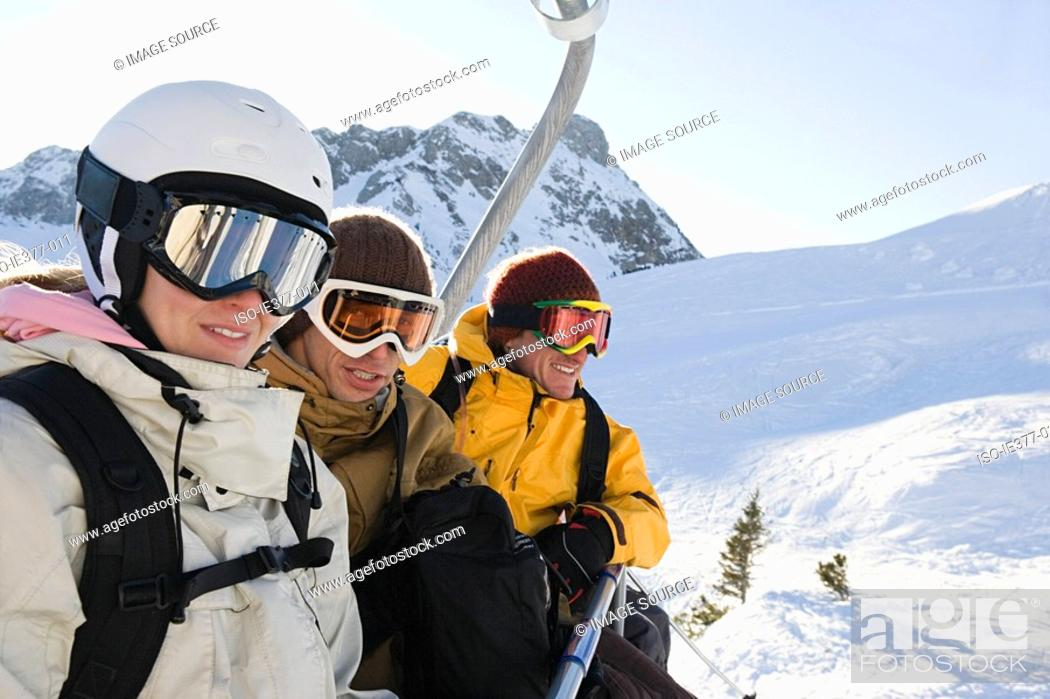 Stock Photo: People sat on a ski lift.