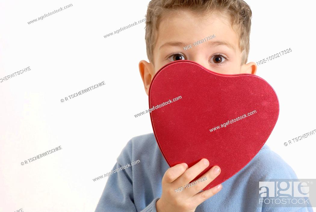 Stock Photo: Little Boy with red Heart.