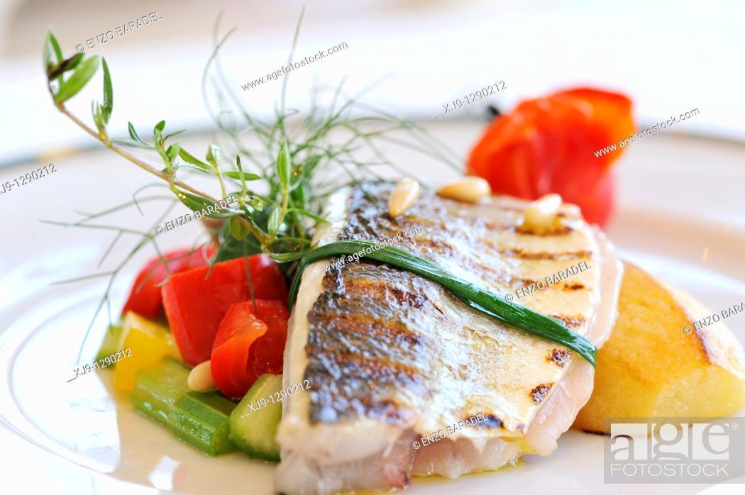 Stock Photo: Hotel restaurant in Venice, sea bass, potato and tomato.