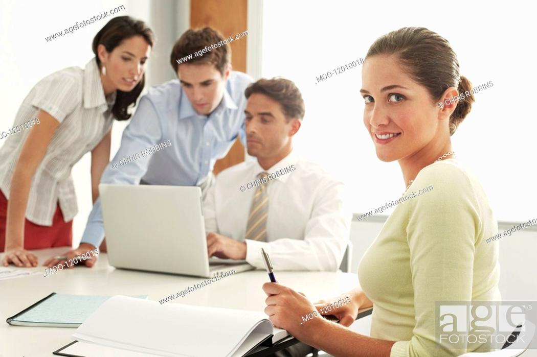Stock Photo: Businessmen and women in meeting.