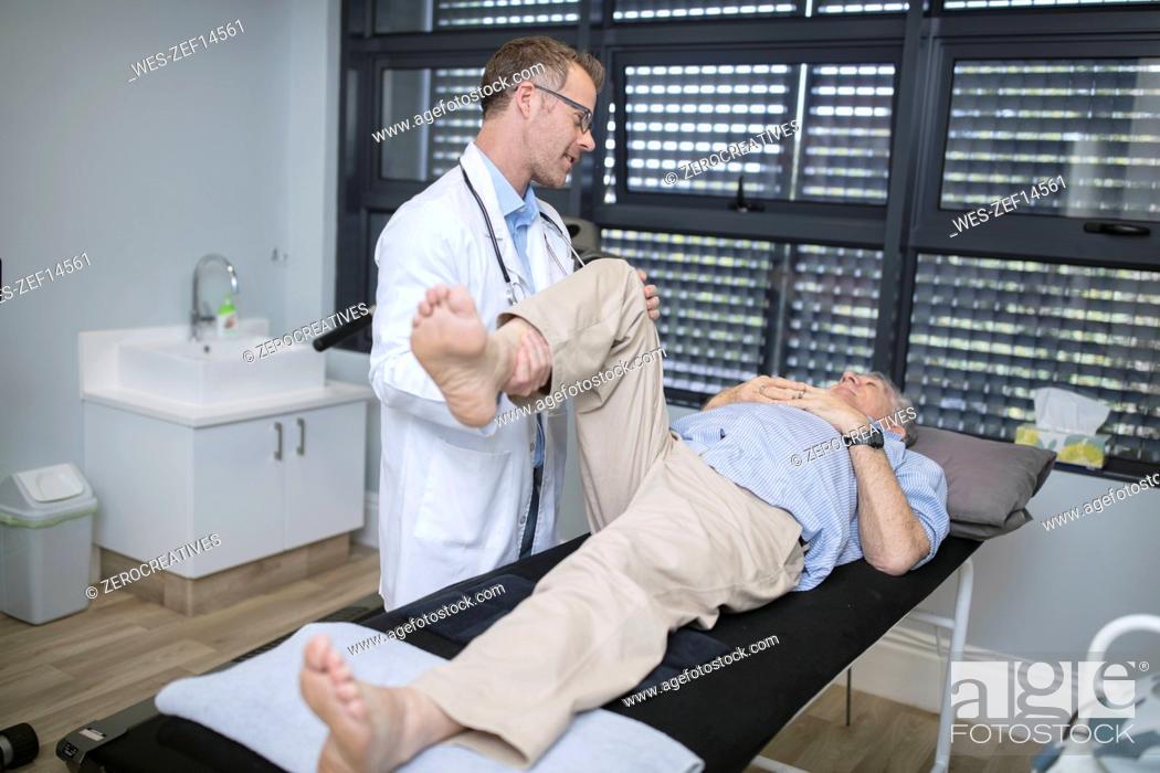 Stock Photo: Doctor examiming senior patient in medical practice.