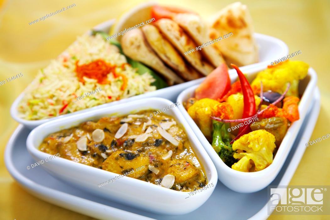 Stock Photo: Indian set lunch meal  Sag mushroom korma and vegetable balti.